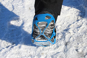 A shoe with snow grips